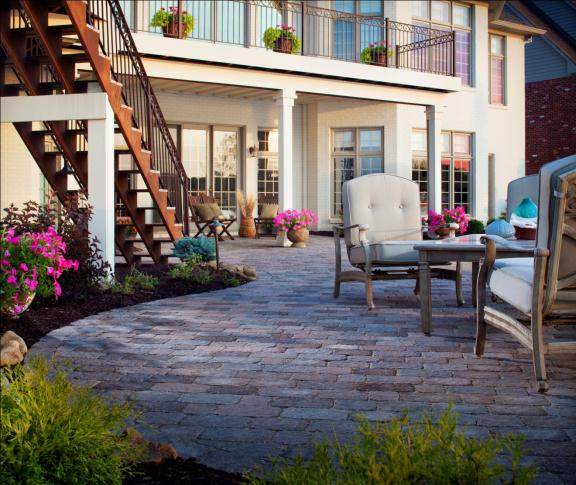 Splashes of color appear throughout this patio in both planted and potted flowers.