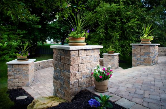 Make a statement by adding a potted plant on top of Belgard columns.